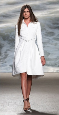 JEANNA:  The classic trench gets a makeover with this pure white textured jacquard long sleeve trench coat with fitted bodice and detachable skirt at waist. This Rolando Santana creation is a luxurious coat that can take you all the way from the office to Labor Day in the Hamptons. $2495