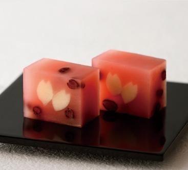 """桜の花びらをあしらった創作羊羹。  Japanese Sweets """"wagashi"""",  Yokan creation decorated with cherry blossom petals."""