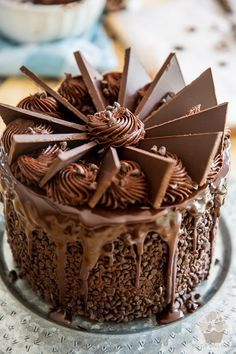 Putting the finishing touches to the cake - part of My Evil Twin's Kitchen's Wicked Windmill Chocolate Cake step-by-step instructions