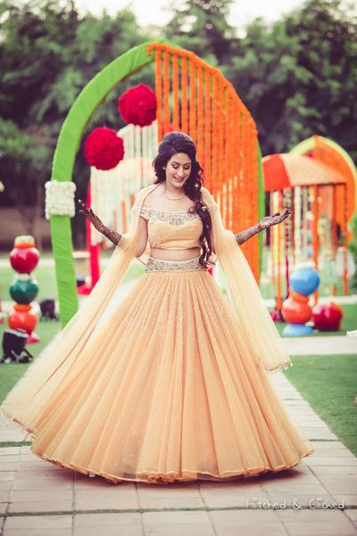 Sangeet Lehengas - Peach Fairytale Lehenga | WedMeGood | Peach Large Flare Lehenga with Silver Waistbelt and Peach Blouse with attached Dupatta #wedmegood #indianwedding #indianbride #peach #net #bridal #lehenga