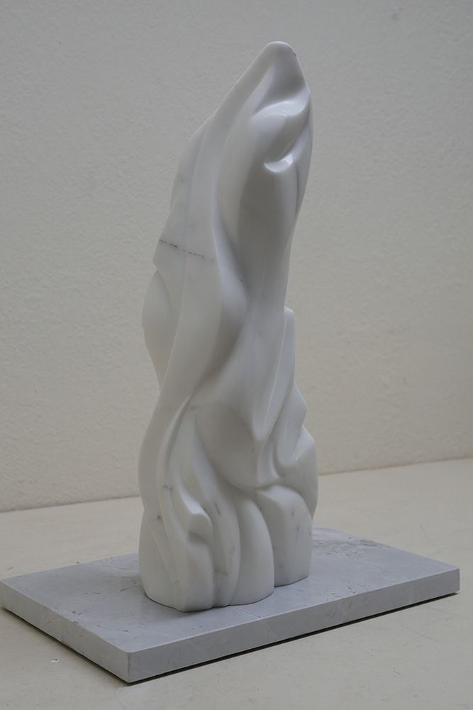 'Ponderosa' 60cm x 22cm x 22cm Carrara Marble on Vancouver Island marble base. Sold at the Sooke Fine Arts Show in 2015.