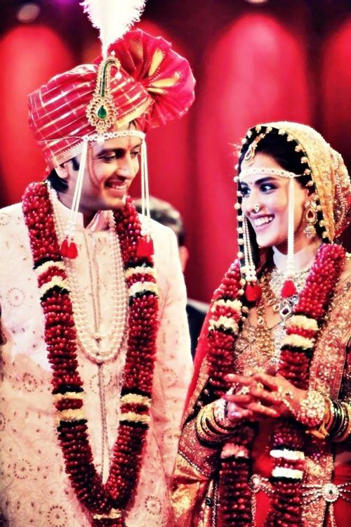 Genelia wore a custom designed Neeta Lulla lehnga for the couple's traditional Maharashtrian wedding.