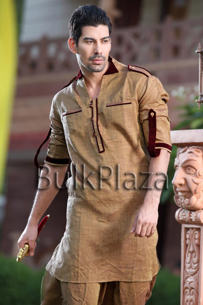 Dashing look golden mustard color linen pathani suit. Innovative velvet patch collar, plackets, flaps and piping makes you stand out from the crowd. It is paired with a matching pathani salwar. Create your own fashion trends thats bound to be sensational.