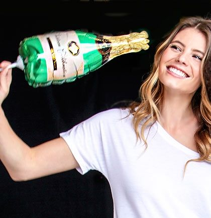 Use this Small Champagne Bottle Mylar Balloon to decorate for any special occasion. Be creative and use the balloon with your guests as a fun photo prop!