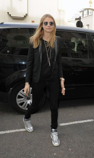 The Best Model-Off-Duty Looks (Updated!): Cara Delevingne channeled Ozzy Osbourne in her round metal sunglasses in London. Her all-black ensemble got a pop of shine thanks to her silver metallic high-top sneakers.