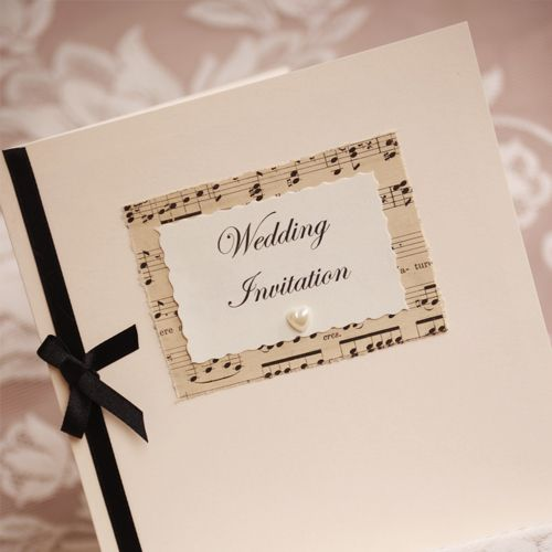 Vintage Music Themed Wedding Invitations...created from vintage music sheets and with pearl heart and satin ribbon embellishment