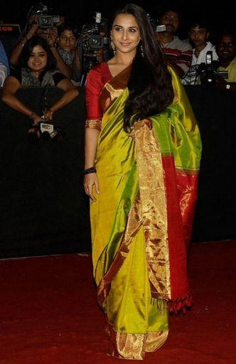 Vidya in Parrot green + Maroon Kanjivaram saree