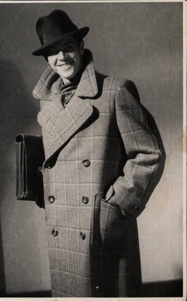 A fabulous late 30s - early 40s Polo Coat on display.