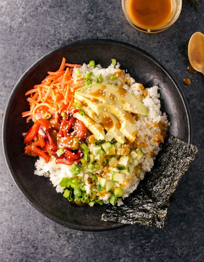 """Vegan """"Sushi"""" Bowls with Soy-Ginger Dressing. This healthy bowl is grain-free and a delicious alternative to eating leafy green salads. Topped with a soy-ginger dressing, you'll want to lick the bowl when you're finished! Raw food and paleo friendly."""