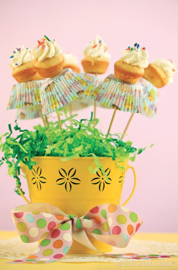 For this yummy project, bake a batch of mini cupcakes and slide them onto bamboo skewers. Push skewers into a square of floral foam and plant them in a sweet little flowerpot! Some icing…some sprinkles…and you're good to grow! TIP: For extra color, layer your little cakes with upturned cupcake wrappers.