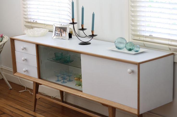 Mid century buffet painted in soft grey-blue and waxed timber. Glass shelves illuminated by LED lights which can be switched in a range of different colours. For sale $1200