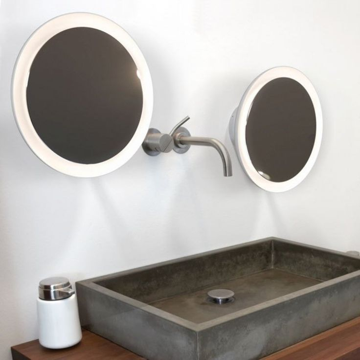 round led mirror light with and a trailing lead allowing you to plug in rather than hard wire rated for bathroom use although can be used
