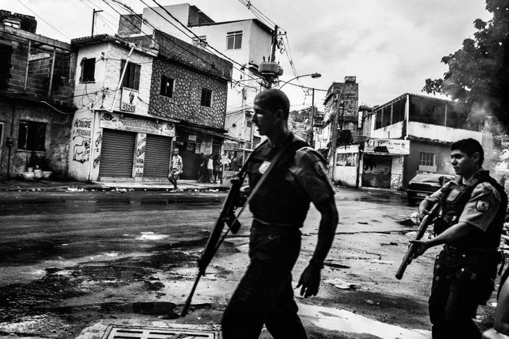 Daily Life, 3rd prize stories. Police patrolling the streets of Vila Aliança after a taxi driver was shot by police; Rio de Janeiro, Brazil, Feb. 8, 2015.