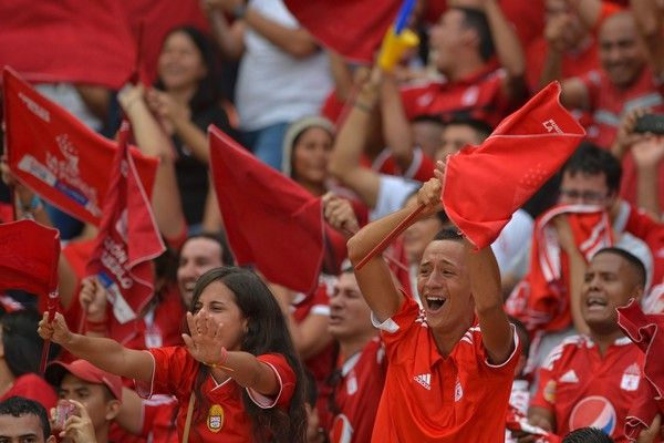 America de Cali's team supporters celebrate after their team defeated Deportes Quindio in a Colombian Professional Football tournament promotion match in Cali, Colombia, on November 27, 2016..America de Cali defeated Deportes Quindio by 2-1 and returned to first division after five years. / AFP / LUIS ROBAYO