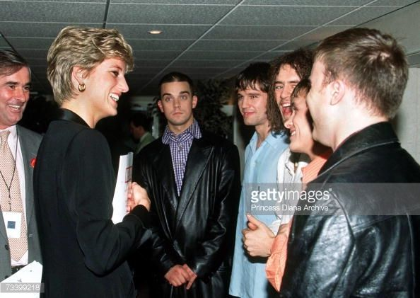 1994--meets pop singer Robbie Williams (centre) and other members of boy-band Take That at a 'Concert Of Hope' AIDS benefit at Wembley Arena, London, 1st December 1994