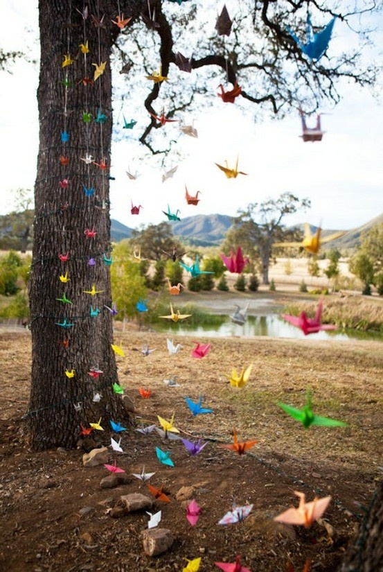 origami - I like the idea of hanging colorful things from trees