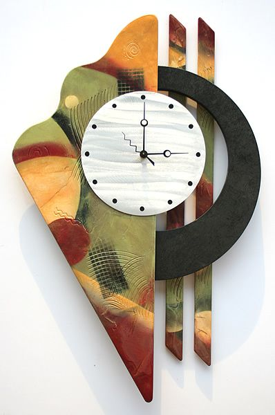 "This is a great contemporary wall clock design! It has a brushed aluminum 8"" clock face with beautiful blended and texturized colors with a faux painted black circle."