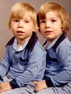 Ashton Kutcher, right sitting next to his fraternal twin brother, Michael.