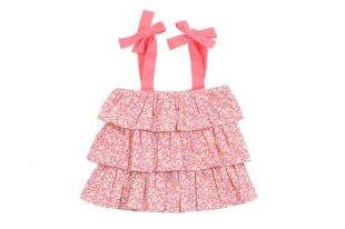 Blusa para bebe niña, con vuelos y estilo strapless en tela estampada con florecitas miniatura en varios colores. Dos lazos sobre los hombros en rosado fosforescente.