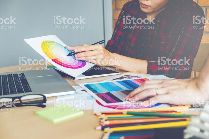 Two Graphic designer drawing on graphics tablet and color palette guide at workplace royalty-free stock photo