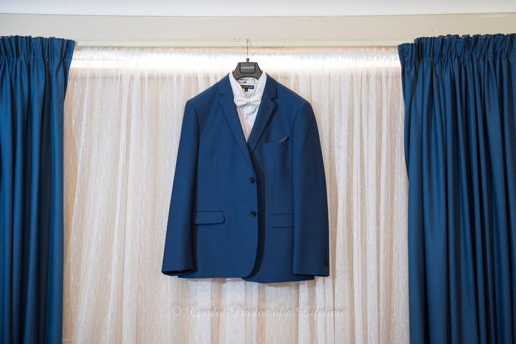 Wedding Photographer, Candid Photos of a Lifetime - the groom's suit...
