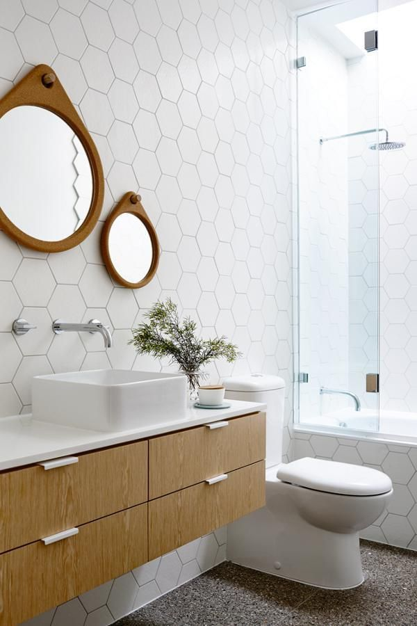 large hex on wall // floating vanity // vessel sink // wall mounted faucets // modern toilet