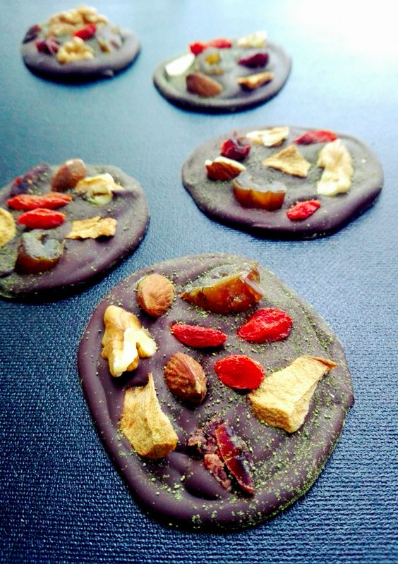 Healthy chocolate snack with dry fruits, nuts and matcha tea.