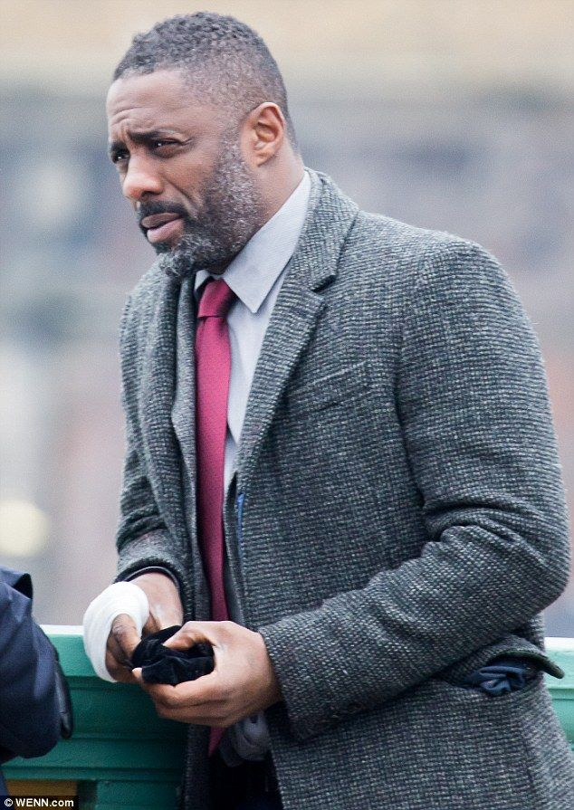 Handsome: Flanked by the city's impressive skyline, the critically-acclaimed star cut a dapper figure in a shirt and tie as he recorded scenes for the new series of the smash-hit show