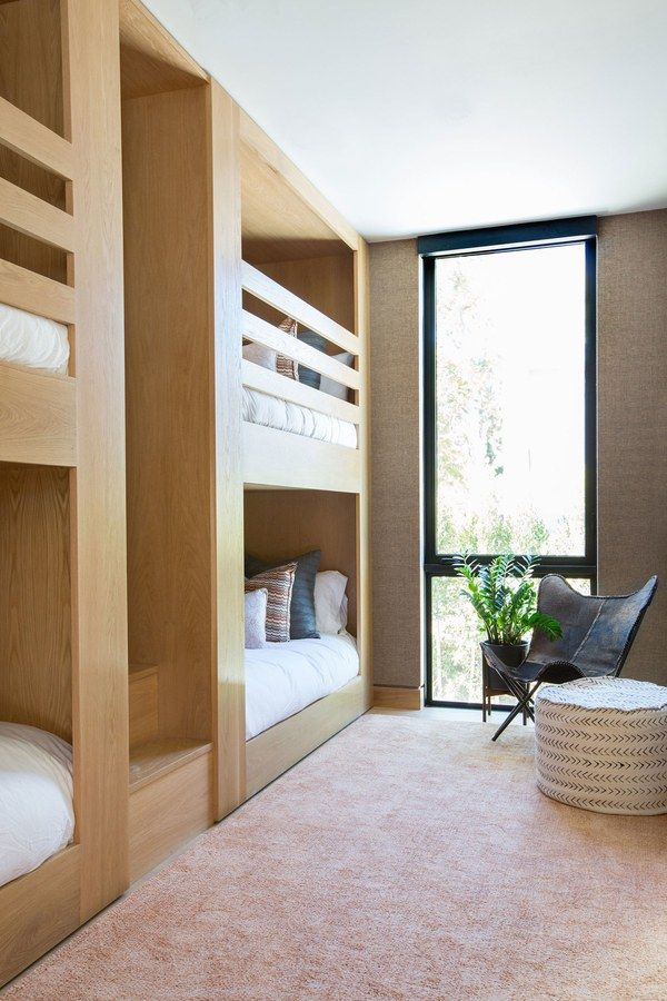 Custom bunk beds maximize space for visiting guests | archdigest.com