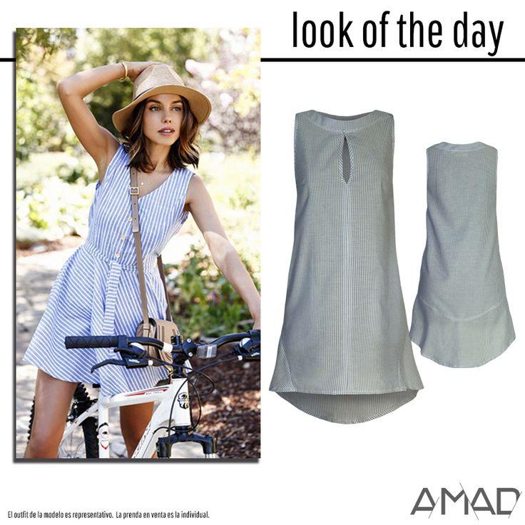 Vestido de rayas, bolsas laterales, escote ojal, largo asimétrico