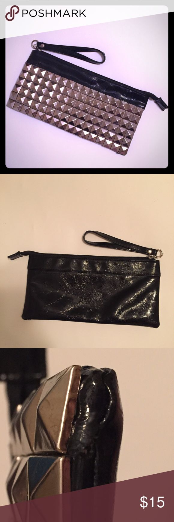 Rockstar Studded Clutch Wristlet Purse Edgy but understated clutch. Covered in gunmetal pyramid studs. Gives your outfit a little edge. Wore this to a lot of concerts. Would also be great to wear at a Halloween costume party. A little wear on the right bottom corner (see pic). Inside is very clean. Has a small inner zip pocket. EUC 🚭smoke free home Body Central Bags Clutches & Wristlets