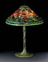 TIFFANY STUDIOS A 'POPPY' LEADED GLASS AND BRONZE TABLE LAMP, CIRCA 1910 Price realised USD 337,000 Estimate USD 125,000 - USD 175,000