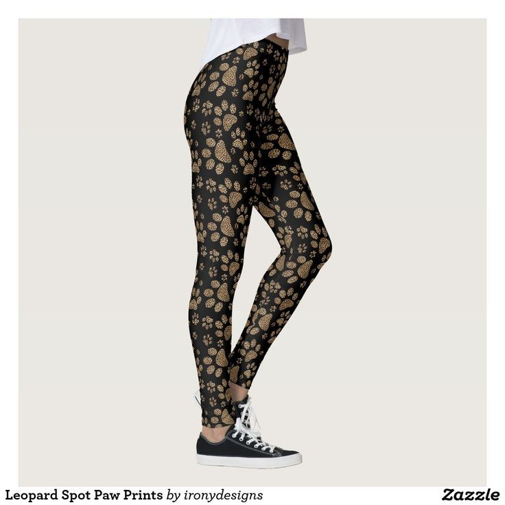 Leopard Spot Paw Prints Leggings / Yoga Pants. Leopard Skin Design made with brown leopard spots inside the big cat paw prints on a black colored background. Elegant wild cat lover and pet lovers design with the leopard pattern print.