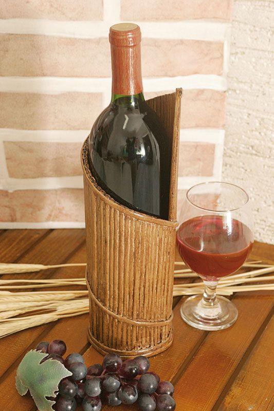 Tejiendo periódicos. Soporte para el vino a partir de tubos de periódicos ..