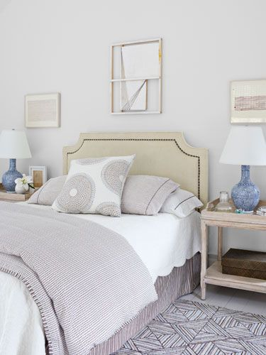Don't be afraid to mix-and-match by pairing geometric carpeting with patterned bedding. #personalstyle #decorating