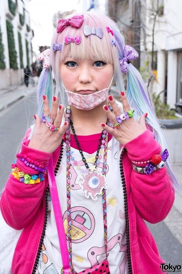 Harajuku Subculture. Decora style. Pinkie girl with lots of hairpins, rings, and bangles...