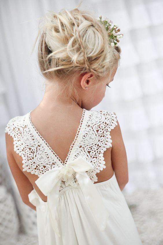 Crisp white wedding inspiration for the flower girl with the prettiest back…