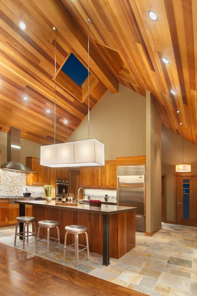 While High Ceilings Are Architecturally Appealing They Present Challenges For Installing Vaulted Ceiling Lighting High Ceiling Lighting Ceiling Fan In Kitchen