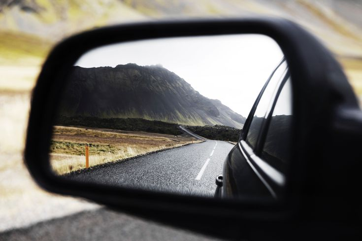 [#HD Wallpaper] The view of a mountain, road, and field from a car side mirror in Snæfellsjökull - Vehicle blind spot, #Car #Driving #Safety Advanced driver-assistance systems, #RearviewMirror Lane departure warning system, Intelligent Parking Assist System  - Photo by Kalle K @kallek (unsplash)  - Follow #extremegentleman for more pics like this!