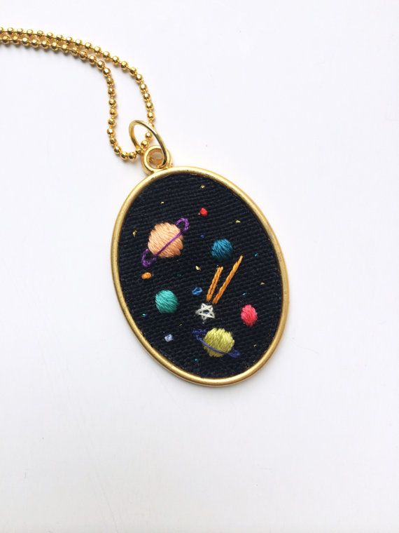 Some planets and stars has embroidered by hand onto a black cotton fabric with DMC mouline %100 cotton threads.  Details:    -The pendant is in