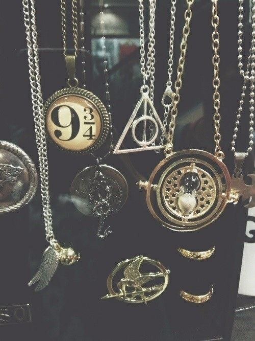 The ultimate nerdy jewelry collection omg -harry potter -hunger games -batman -lord of the rings/the hobbit Its all there!