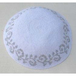 This high quality white knit kippah is trimmed in a graceful scroll silvery metallic pattern. This beautifully crafted kippah is elegant, stylish and sophisticated; wear it each time for services or save it for high holiday or a simcha. Kippah measures 17 cm.