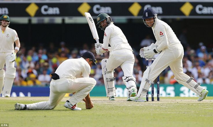 Alastair Cook at first slip takes a low catch to remove Nathan Lyon, the final Australian wicket, off the bowling off Joe Root