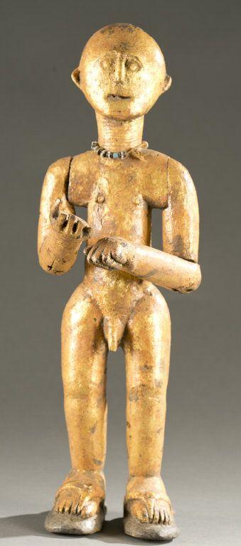 Bron figura masculina de pie con pan de oro, 20 c.