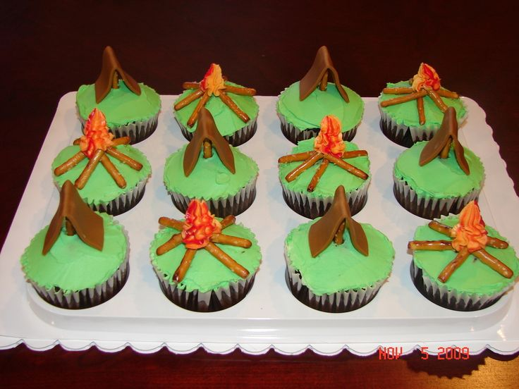 Gone Camping Cupcakes Gone Camping Cupcakes These chocolate cupcakes are iced in BC. I used MMF for the tents and simple stick pretzels for the camp fire logs....