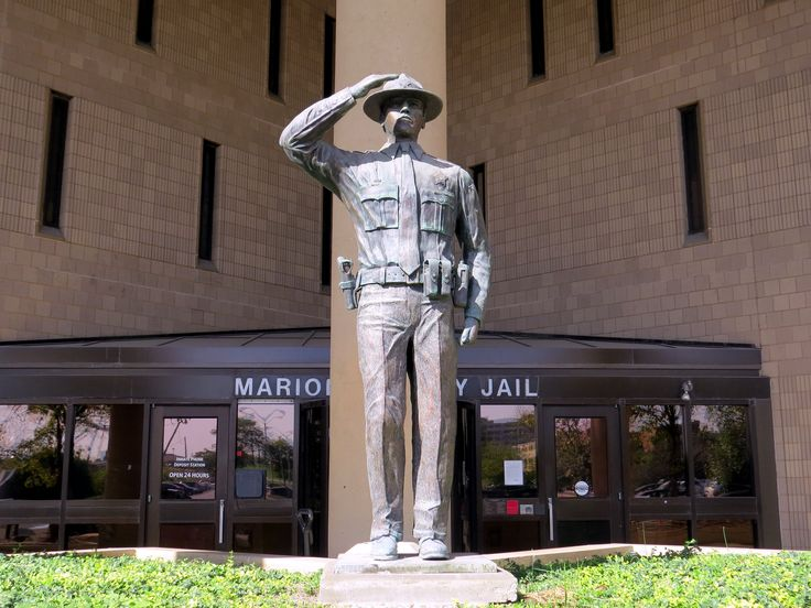 https://flic.kr/p/ybcKvo   This is the MARION COUNTY JAIL in Indianapolis.   The City-County building is the seat of city and county government and the office of Mayor Greg Ballard. Also the Indianapolis Metropolitan Police Department resides in the City -County building without a statue.