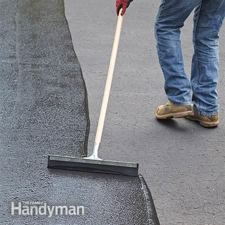 Spread the sealer - How to Seal an Asphalt Driveway: http://www.familyhandyman.com/masonry/how-to-seal-an-asphalt-driveway/view-all