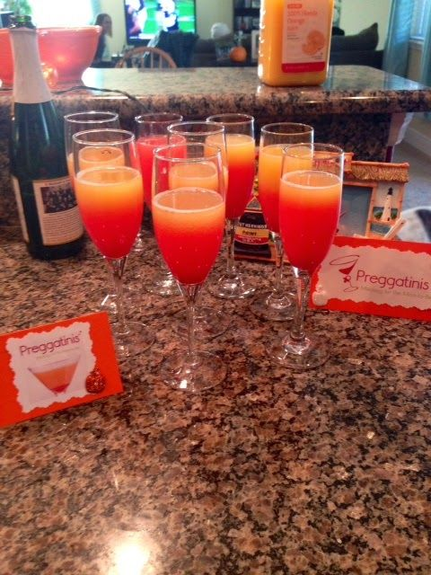 Baby Shower Preggatinis ~ sparkling cider, OJ, grenadine, and a cherry served in champagne glasses. Fancy drink for the momma to be.