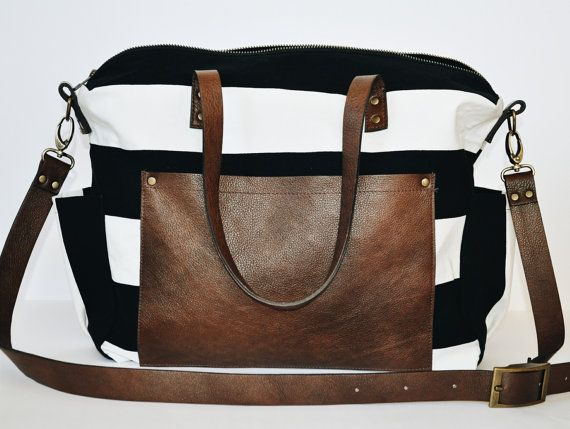 This functional and stylish diaper bag is perfect for any mom. It's made from heavyweight canvas material with leather straps and a leather front