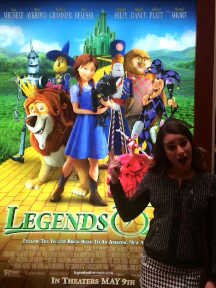 Lea in front of the Legends of Oz: Dorothy's Return poster on the Glee set
